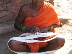 One of Koraput's tribal weavers working on a batch of raw silk