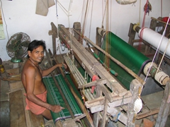 Working a traditional loom for beautiful hand-made cloths