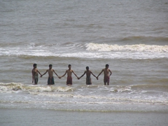 Beachgoers enjoying Puri's pristine beaches
