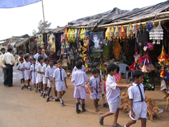 School children in single file near Konark's Sun Temple