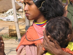 Dongariya tribeswoman and child (notice her hair is parted to one side and adorned with hair clips)