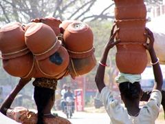 Incredible balancing trick...clay pots being transported