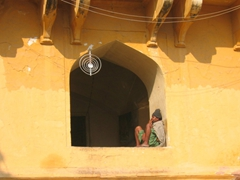 Man relaxing in window, Amber Palace