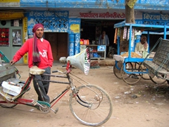 One of India's countless rickshaw drivers poses for a photo