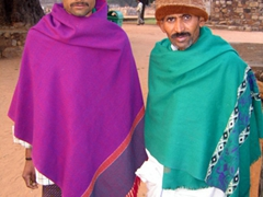 These two colorfully garbed visitors to Delhi's Qutb Minar appear quite stern faced in their portrait. They then proceeded to break out into toothy grins upon seeing their image on the viewfinder