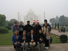We donned our Santa hats for a group photo in front of the Taj Mahal on the day before Christmas; Agra