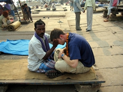 Robby becomes putty in this guy's hands, an entrepreneurial man who set up a riverbank massage service; Varanasi