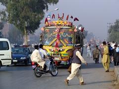 Colorful bus loaded to max capacity, Peshawar