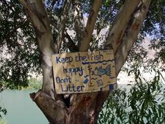 """Read and heed """"Keep the fish happy, Don't litter"""", a Sadpara Lake sign at the Lake View Motel"""