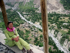 Becky sits down outside the mosque with Chakhchun Village below