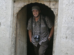 Robby stands under a portal to the Khapulo Fort