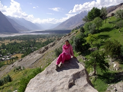 Becky perches on a rock, soaking in Shigar's raw beauty
