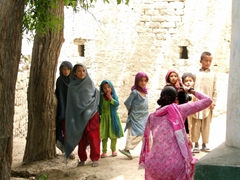 Village children pose for a portrait while Becky snaps away