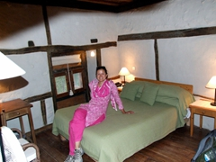 Becky lounges on our bed as we get ready for dinner; Shigar Fort
