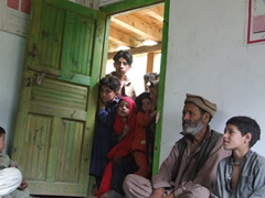 Once we were escorted into the house, the kids piled up at the door, hoping to catch glimpses of us and hear our conversation
