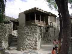 Children playing on the outskirts of Ganish Village beside the famed water tank