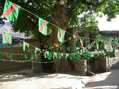 Festival flags adorn the alleyways of the Altit Fort area