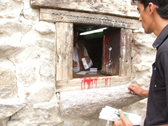Zia buys our entrance tickets to Baltit Fort