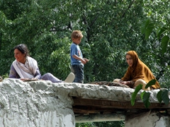 Local villagers are busy drying apricots on their rooftops; Old Ganish Village