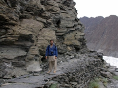 Robby pauses for a breather on the rocky path to Passu Glacier