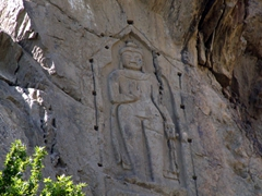 The 7th Century Kargah Buddha, a large standing Buddha, is etched into the rock face near Gilgit and still perfectly preserved