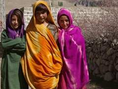 These colorfully clad village girls followed us part way to bid us farewell