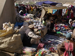 Vendors lay out their wares for sale. Due to the elevation, the most popular items are warm blankets!