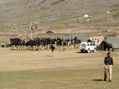 A formation of police huddles to receive their daily orders. Security is serious business at Shandur