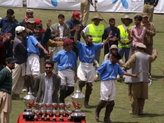 Gilgit's B team dances on the field, celebrating their win over Chitral, 8-1