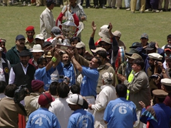 Gilgit polo players proudly display their trophy