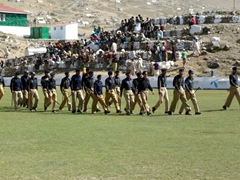 Policemen strolling across the polo field to assume their positions - the opening match is about to get under way