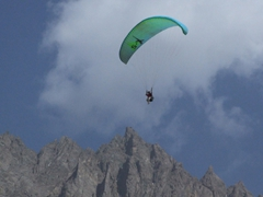 A parachutist soars above the Shandur Plains
