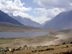 Dust is all that remains once the fully loaded vehicles speed off at the end of the final match; Shandur Polo Grounds