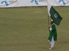 A Pakistani flag bearer struts his stuff on the field of play; Shandur Polo Festival