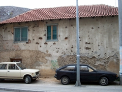 Bullet-strewn buildings are unfortunately a common sight in Bosnia