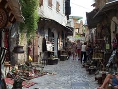 Mostar's cobblestoned street full of souvenir stalls