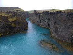 Pretty turquoise river of Sigöldu Foss