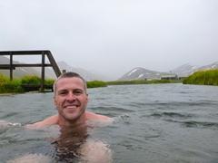 Robby soaking in the hot spring of Landmannalaugar