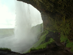 View from behind Seljalandsfoss. Make sure to wear waterproof gear as you will get super soaked!