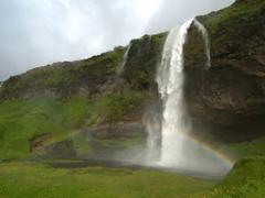 A rainbow appears before Seljalandsfoss