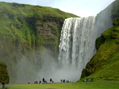 The powerful waterfall of Skógafoss can be seen from Ring Road (Rt 1). It is one of Iceland's biggest, with a height of 200 feet and a width of 80 feet