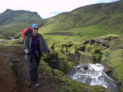 Despite the heavy pack, Becky smiles on the long hike to Thórsmörk. The first third of the hike skirts dozens of waterfalls, and the surrounding scenery is spectacular