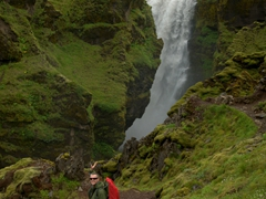 Robby strikes a pose next to one of the many waterfalls on the Fimmvörðuháls hike