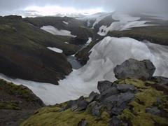 At the 3 to 4 hour mark of the Fimmvörðuháls hike, the scenery becomes increasingly snow covered. Once we crossed a bridge over the Skógá River, the terrain became even more desolate
