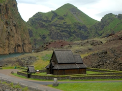 Picturesque view of the Heimaey Stave Church, nestled in the harbor of the Westman Islands