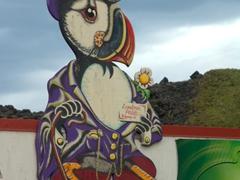 A puffin mascot at a bar; Heimaey Island
