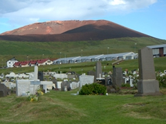 Eldfell Volcano looms over the island's cemetery; Westman Islands