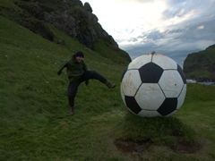 Robby kicks a massive soccer ball; Heimaey Island