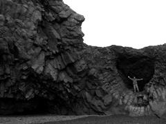 Robby strikes a pose on top of the basalt cliffs of Kirkjufjara