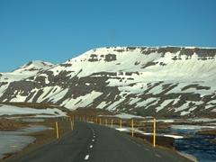 Snow still covers the mountains up at the Fjardarheidi Pass leading to Seyðisfjörður